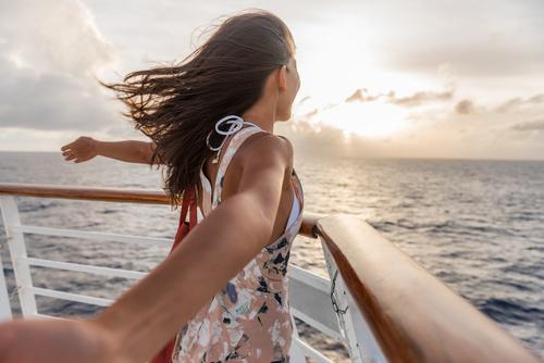 Cruise ship vacation travel woman enjoying freedom. Holiday tour