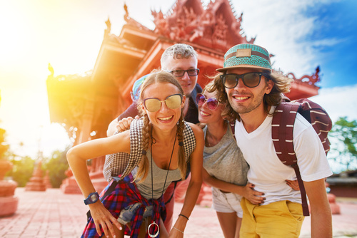 tourists posing in front of temple in koh samui thailand