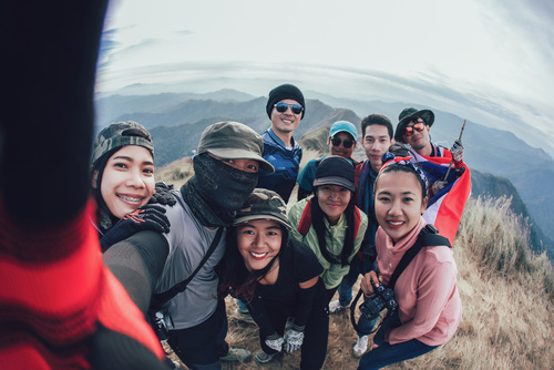 Friends Taking Selfie at the top of mountain